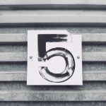 The number 5 on a metal grated wall